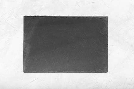 Photo for Empty Black slate Tray Plate isolated on white textured background. Top view Mock up - Royalty Free Image