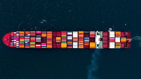 Container ship carrying container for business freight shipping import and export, Aerial view container ship arriving in commercial port, Container loading Cargo freight ship.