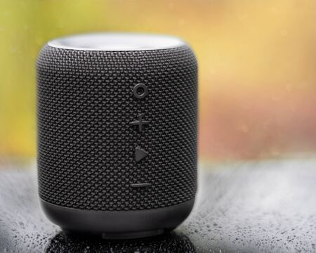 Photo pour An awesome portable wireless bluetooth speaker for music lovers. Shot is taken on a black surface. - image libre de droit