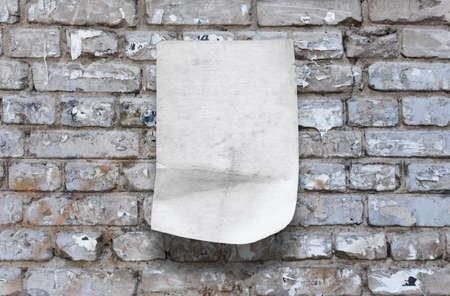 Foto de old paper on brick wall - Imagen libre de derechos