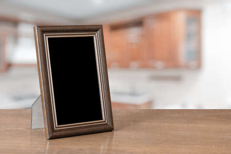 Photo pour photo frame on the wooden table in the living room - image libre de droit