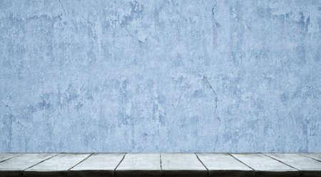 Photo pour Studio table background with blue wall - image libre de droit