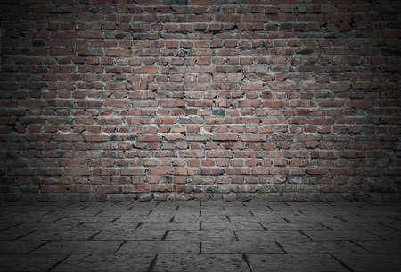 Foto de Empty room with bricks wall and tiled floor. Dark background. - Imagen libre de derechos