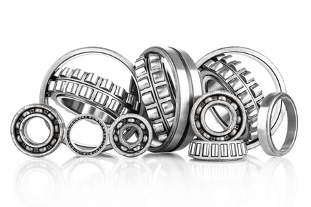 Photo pour Composition of steel ball roller bearings in closeup isolated on white background - image libre de droit