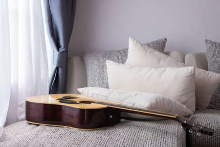 Photo pour white bed with guitar in living room. - image libre de droit