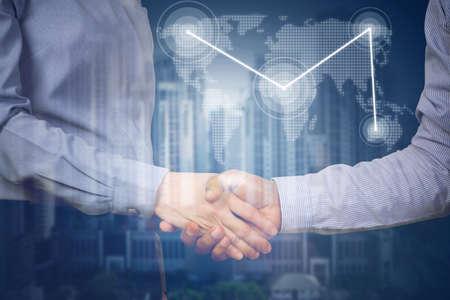 Photo pour handshake business partners with virtual map link and business building, concept of business commitment. - image libre de droit