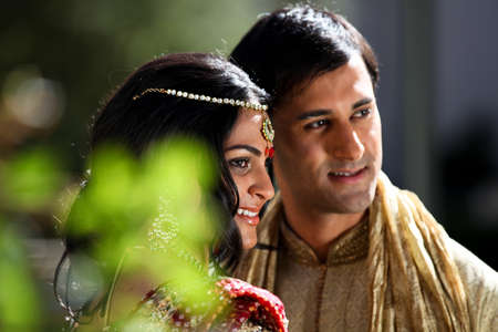 Image of a gorgeous Indian bride and groom traditionally dressedの写真素材