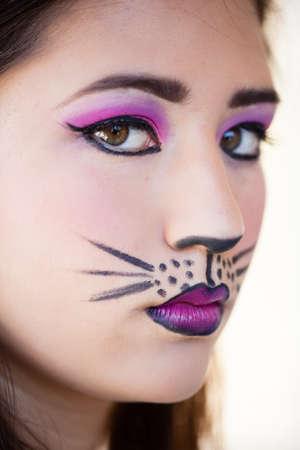 Pretty Brunette woman in cat makeup
