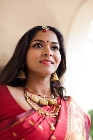 Photo pour Beautiful Indian Bride in Cathedral Hallway on her wedding day - image libre de droit