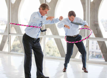 Photo pour Businessmen having a hooping contest in a modern office to get ideas flowing - image libre de droit