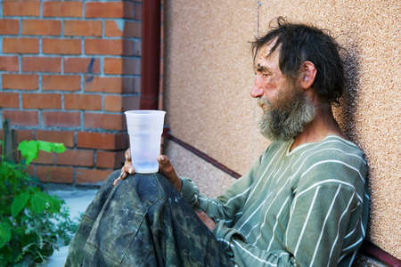Photo for Homeless poor alcoholic in depression. - Royalty Free Image