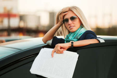 Tired businesswoman with financial reports
