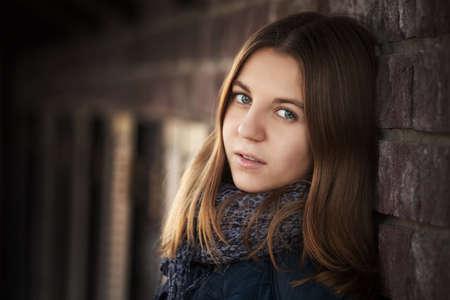 Photo pour Teenage girl against a brick wall - image libre de droit