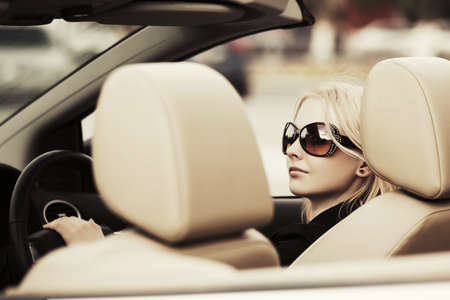 Photo for Happy young fashion woman driving convertible car - Royalty Free Image