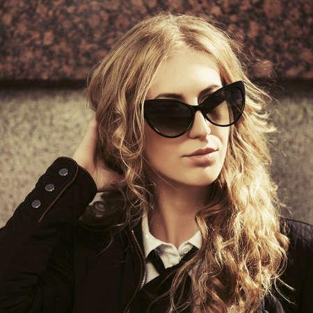 Photo pour Young fashion blonde business woman Stylish female model in black jacket and sunglasses - image libre de droit