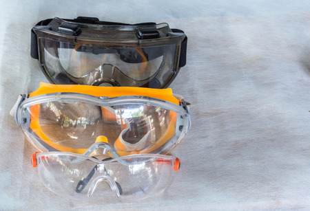 Foto de goggle and glasses for eye protection on gray background - Imagen libre de derechos