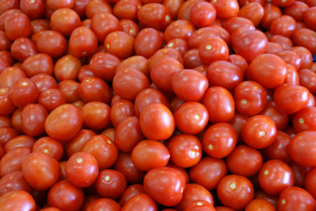 Robust tomatoes at a market stall. Market.