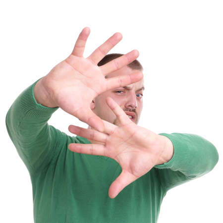 disgusted young man with raised hands