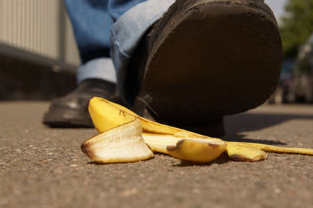 person about to slip on a banana peel or banana skin