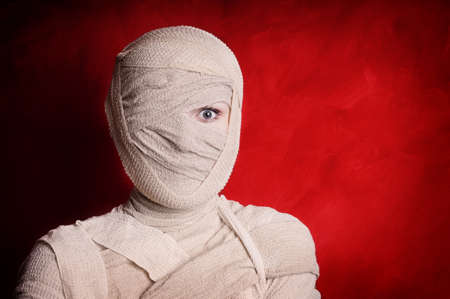 woman wrapped up with bandages as a mummy halloween costume