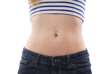 belly button or navel piercing isolated on white