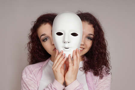 two-faced happy sad woman manic depression or schizophrenia concept