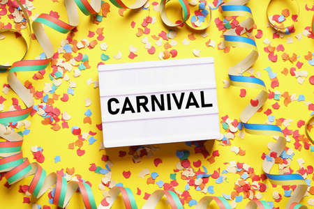 Photo pour carnival flat lay with text on light box sign confetti and streamers - image libre de droit