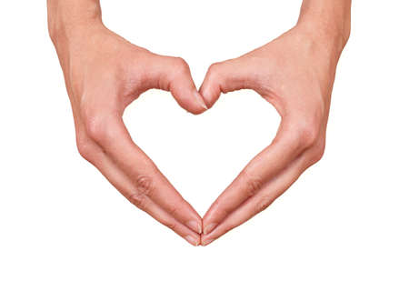 Female hands making a heart, can represent: health, love, caring or beauty