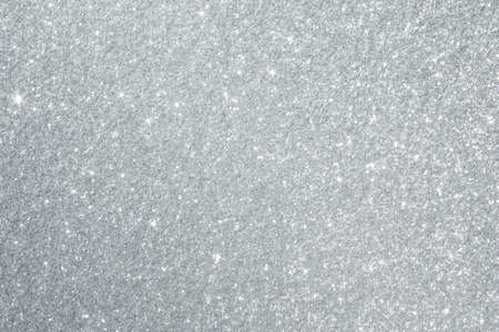 Glittery silver background texture perfect for Luxury, fashion or Christmas and holiday season designs.