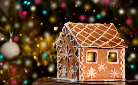 Christmas Gingerbread House Background.Gingerbread House With Lights On Christmas Background