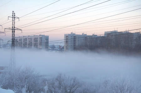Winter city at the fog in Siberia