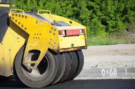 Yellow rolling machinery wheel at work closeup