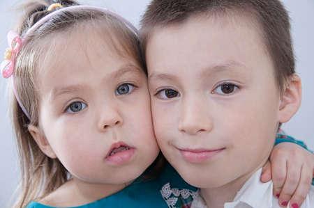Photo pour Happy children. Boy and girl portrait. Children close up faces. Siblings together - image libre de droit
