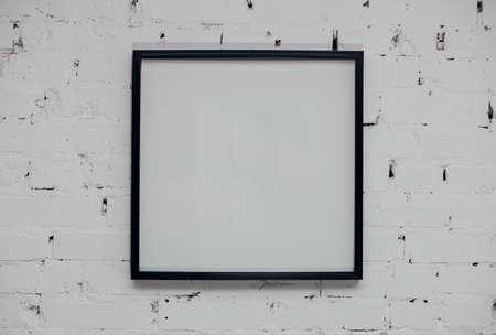 Photo pour Blank picture frame at the brick wall - image libre de droit