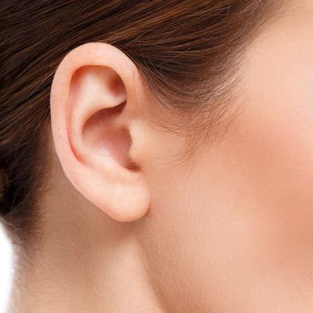 Foto für closeup of woman ear - Lizenzfreies Bild