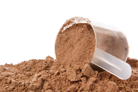 Close up of protein powder and scoop