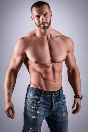 Handsome muscular man posing in studio