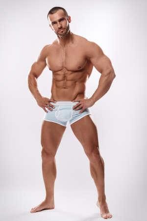 Photo pour Handsome man posing in underwear on white background - image libre de droit