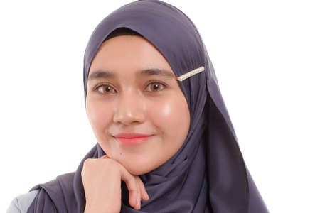 Photo pour Beautiful Asian Muslimah woman model posing on white background with different expression. - image libre de droit