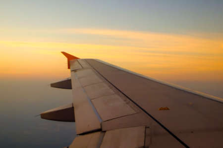 Photo pour Flying and traveling, view from airplane window on the wing on sunset time - image libre de droit