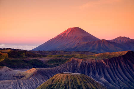 Photo pour The beautiful sunrise at Mount Bromo volcano, the magnificent view of Mt. Bromo located in Bromo Tengger Semeru National Park, East Java, Indonesia.Image contains noise grain and blurry. - image libre de droit