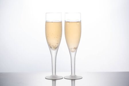 Photo for glasses of champagne on a white background. front view - Royalty Free Image