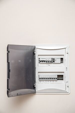 Photo pour Electricity distribution box. Fusebox. Isolated on apartment wall - image libre de droit