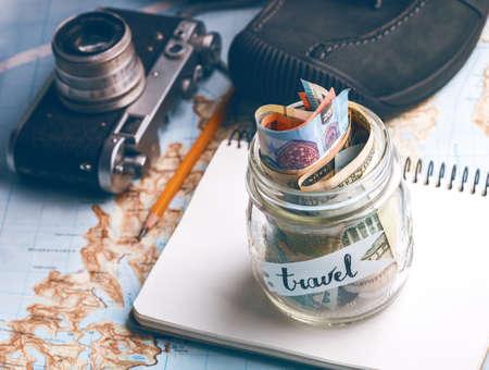 Photo pour wanderlust. adventure concept. background - what to take for a trip - camera, jar with money,  shoes  - image libre de droit