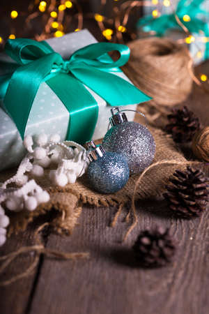 Photo for Christmas - a group of gifts on the background of garlands - Royalty Free Image
