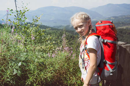 Photo for Ukrainian landscape.  happy smiling girl child at the  mountains in Carpathians,  Ukraine - Royalty Free Image