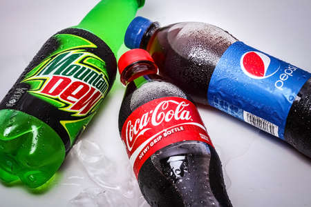 SABAH, MALAYSIA - JANUARY 13, 2015. bottle of Coca-cola, Pepsi and Mountain Dew drink isolated on white.