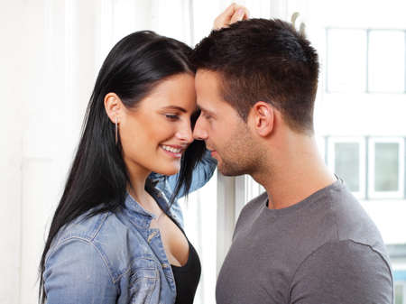 Loving couple smiling at each other