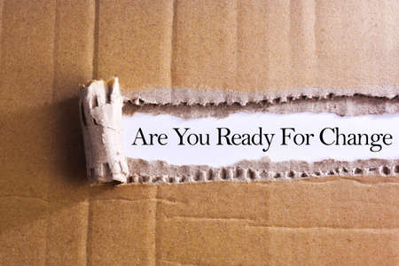 Torn paper box with word Are you ready for change
