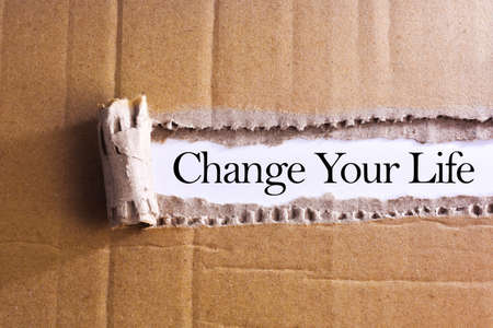 Torn paper box with word Change your life